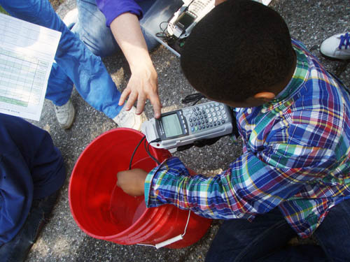 A student uses a Vernier meter to study water quality parameters.